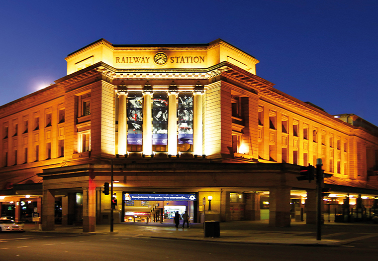 Adelaide Railway Station lit up at night