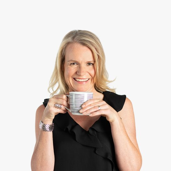 Kate Hannemann Managing Director drinking a cup of tea