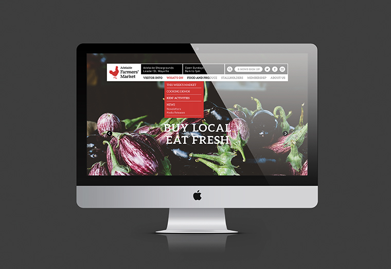 Adelaide Showground Farmers' Market website homepage designed by communikate et al shown inside an Apple Mac screen