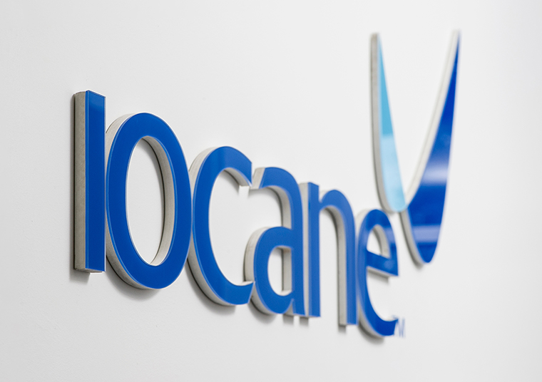 Iocane wall signage displayed on a wall designed by communikate