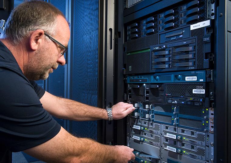 Iocane staff member fixing a server