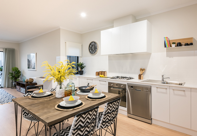 Beautifully designed kitchen and dining table set up for a meal
