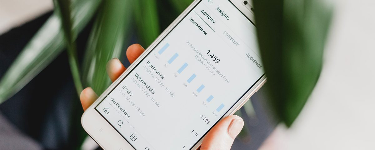 Mobile phone showing social media statistics