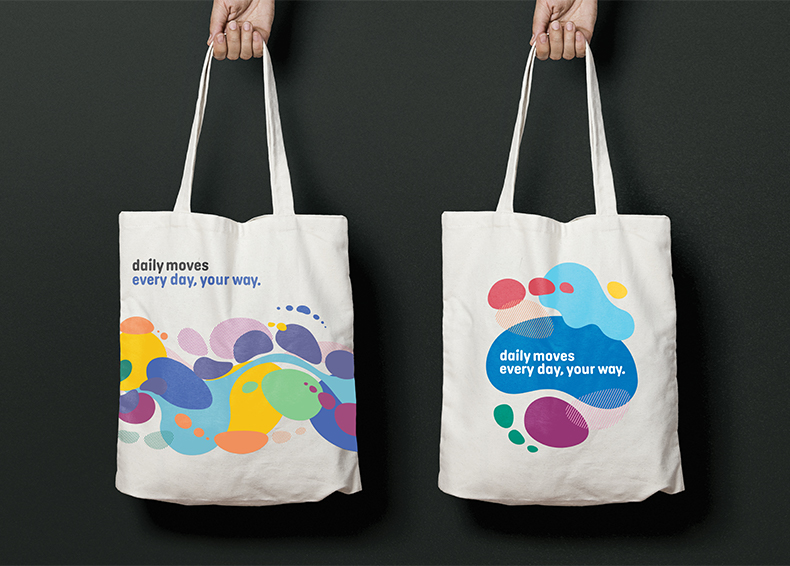 Daily Moves slogan and icons printed on reusable bags designed by communikate