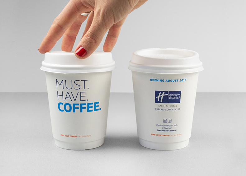 Holiday Inn Express signage printed on takeaway coffee cups designed by communikate et al