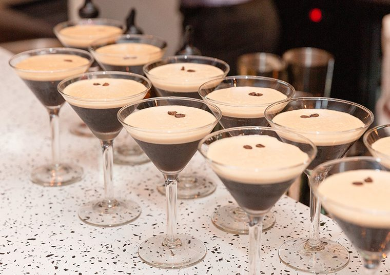 Espresso martinis all lined up on a bench ahead of the HIEX event