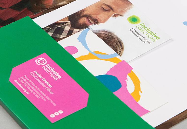 Inclusive Directions document folder containing a newly branded business card and stationery designed by communikate