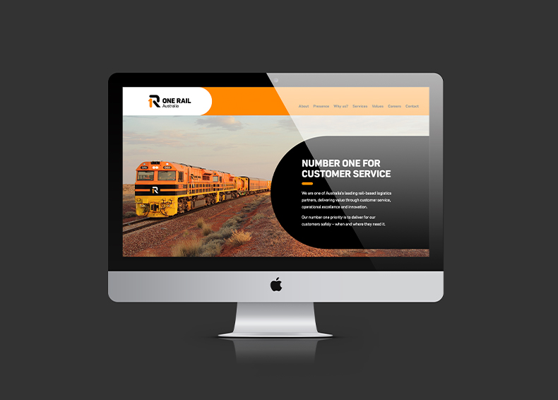 One Rail Australia website homepage shown inside an Apple Mac screen designed by communikate