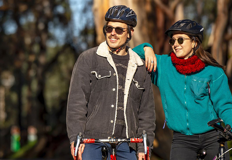 Two cyclists gazing into the distance